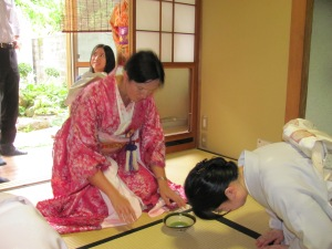 Partaking in a tea ceremony, Kyushu