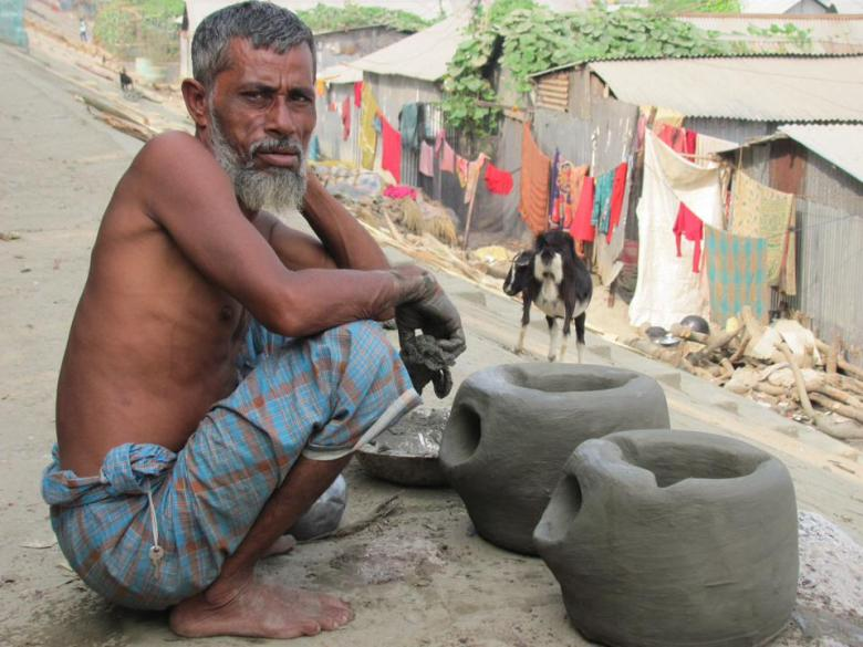 Making clay stoves on the edge of the river slum in Mymensingh, Bangladesh