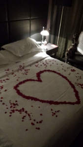Romantic Turndown - complete with rose petals, champagne and candles
