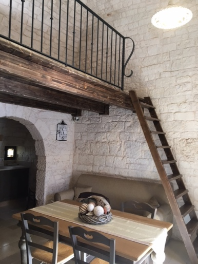 Downstairs living area and the loft with a single bed above
