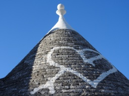 Different icons are painted on many of the trullo roofs